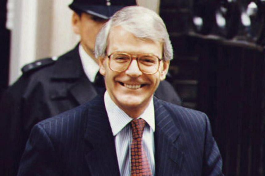 Then British Prime Minister John Major leaving No.10 Downing Street in London on July 23, 1993.