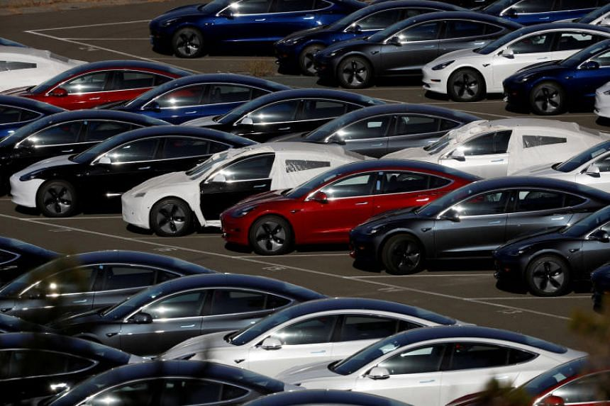 Rows of new Tesla Model 3 electric vehicles in Richmond, California, on June 22, 2018.