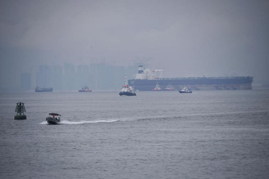 A Singapore Police Coast Guard vessel (far right) patrolling the waters off Tuas on Dec 6, 2018.