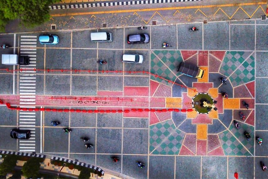 An aerial view of the mosaic street art in front of Surakarta's City Hall. Some have said the design resembles a Christian cross.