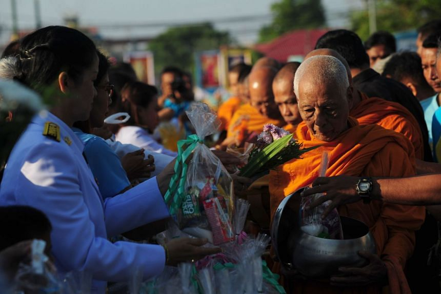 Buddhist monks receiving alms in Narathiwat province in August 2018.