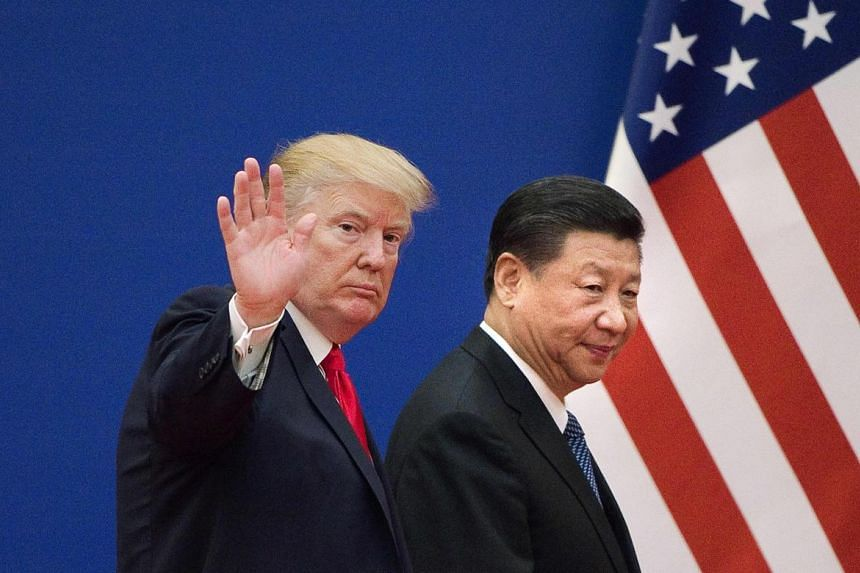 US President Donald Trump and China's President Xi Jinping leaving a business leaders' event at the Great Hall of the People in Beijing on Nov 9, 2017.