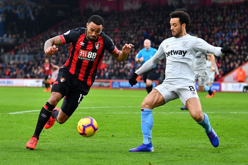 Bournemouth's Callum Wilson in action with West Ham's Felipe Anderson.