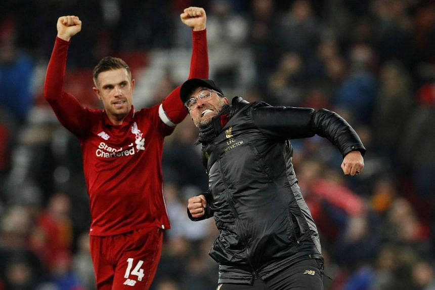 Liverpool manager Juergen Klopp and Jordan Henderson celebrate at the end of the match.