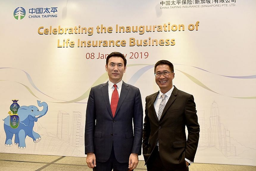 Mr Yang Yamei (left), general manager of China Taiping Insurance Singapore, and Mr Lance Tay, general manager for life insurance, at the inauguration of the company's life insurance business.