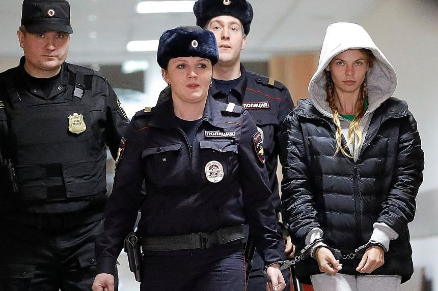 Belarusian model Anastasia Vashukevich being escorted before a court hearing in Moscow yesterday. She was convicted in Thailand last week after she pleaded guilty to multiple charges, including soliciting and illegal assembly. She claimed to have pro