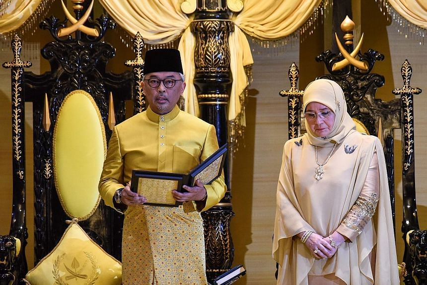 Tengku Abdullah Sultan Ahmad Shah, with his consort, Tunku Azizah Aminah Maimunah Iskandariah. The Sultan is described by his subjects as being a down-to-earth person, and when driving about town, he would randomly pull over his vehicle to play footb