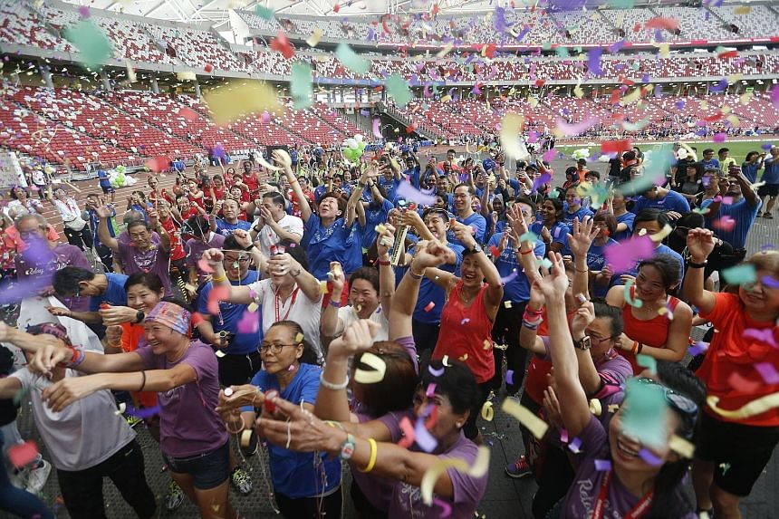 Participants enjoying a mass dance workout after the 15-hour Relay For Life last year. This year's event aims to draw about 7,500 participants and raise $1 million to support the Singapore Cancer Society's beneficiaries, and enhance its programmes an