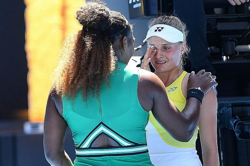 Serena Williams consoling Dayana Yastremska after beating the Ukrainian 6-2, 6-1 in the third round yesterday. Williams will meet world No. 1 Simona Halep for the ninth time tomorrow.