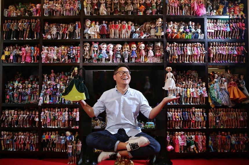 Mr Jian Yang with his Barbie doll collection, and holding Barbie dolls modelled after Scarlett O'Hara (left) and Marilyn Monroe, in his living room on Jan 15, 2019.