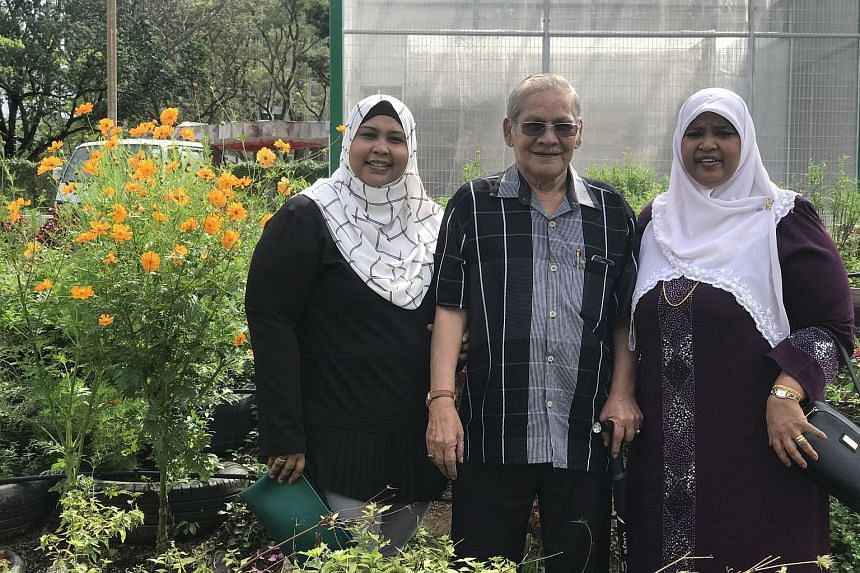 """Madam Hawa Bee Mohammed Hussain (right), her husband Abdul Rahim Moidin and their daughter Wahedah Rahim. Their family was presented the """"Kampung Spirit"""" award by PPIS Oasis for fostering three children with special needs."""