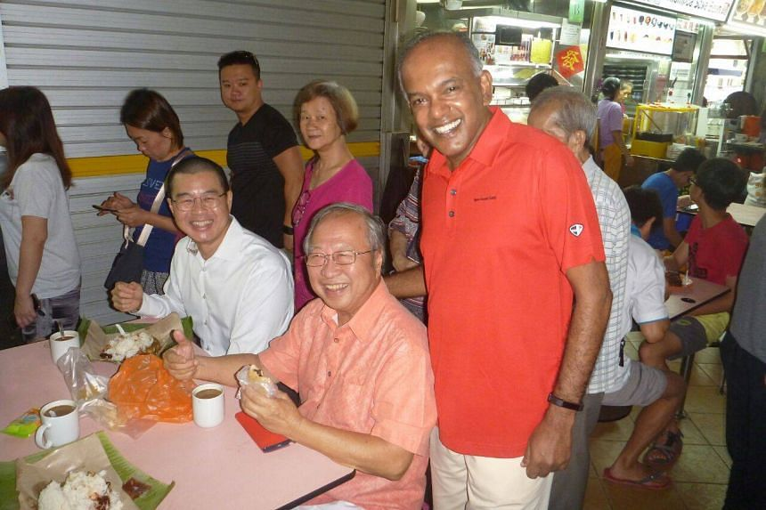 Dr Tan Cheng Bock and Law and Home Affairs Minister K. Shanmugam posing for a photo together at Chong Pang hawker centre, on Jan 19, 2019.