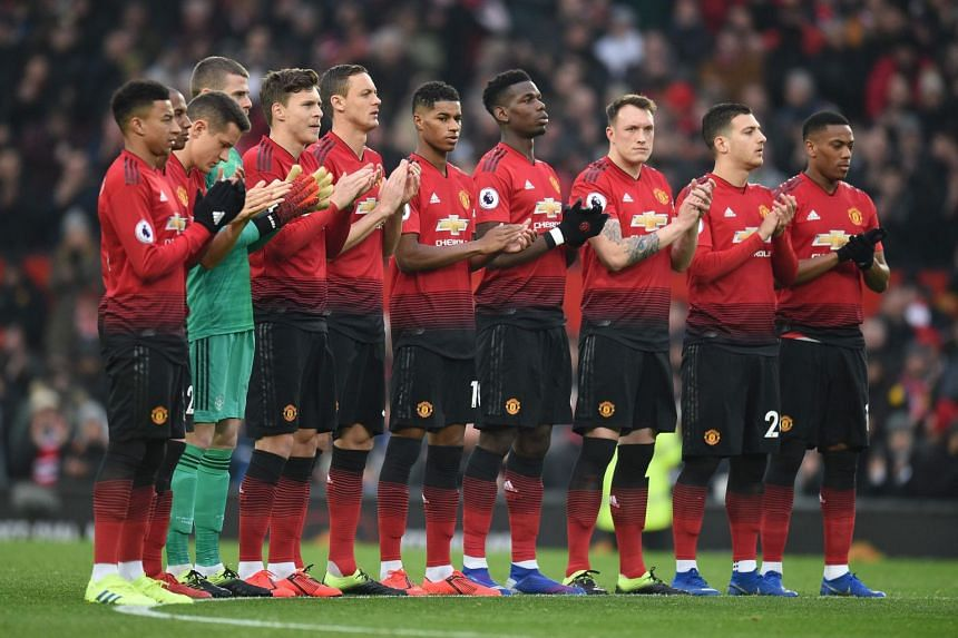 United players applaud late former manager Matt Busby before kicking off against Brighton on Jan 19, 2019.