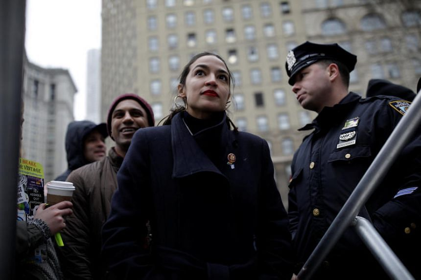 Representative Alexandria Ocasio-Cortez preparing to be introduced to supporters during the Women's March NYC demonstration in Manhattan on Jan 19, 2019.