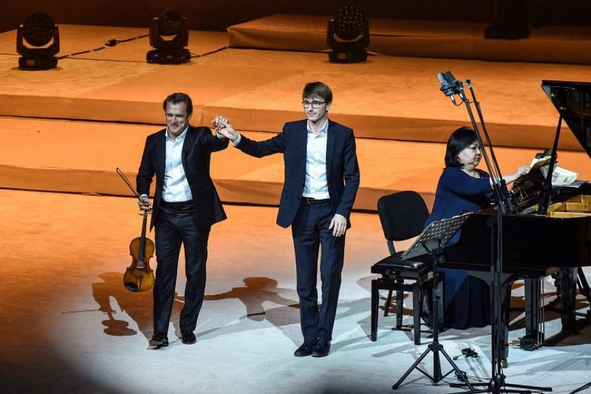 French violinist Renaud Capucon and accompanying pianists saluting the audience during the first Winter At Tantora music carnival, at the Maraya concert hall in Al-Ula in Saudi Arabia on Jan 4, 2019.