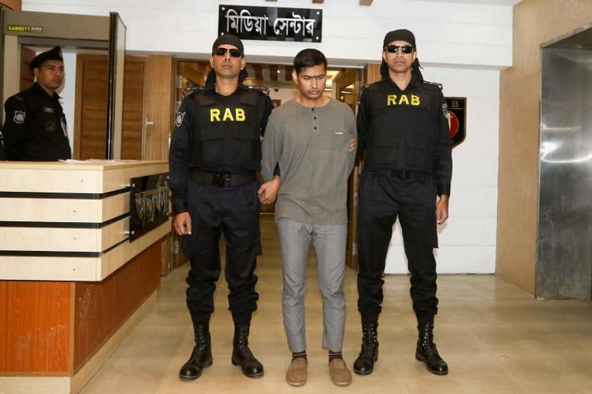 The Rapid Action Battalion officers escorting arrested suspected militant Mamunur Rashid in Dhaka on Jan 20, 2019.