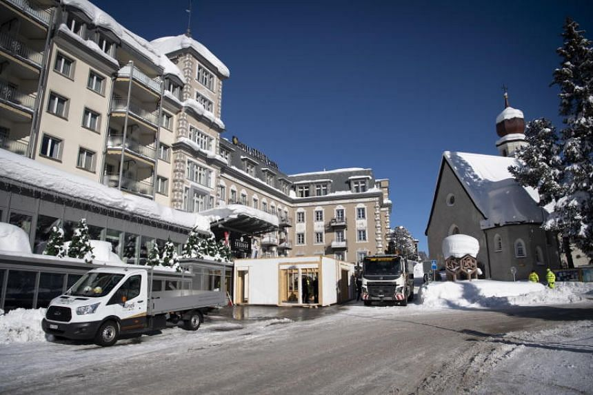 Vehicles are seen parked outside the Hotel Seehof Davos prior to the World Economic Forum on Jan 15, 2019.