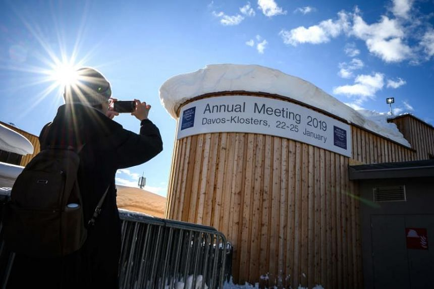 A visitor snapping a photo of the Davos Congress Centre ahead of the World Economic Forum meeting, on Jan 20, 2019.