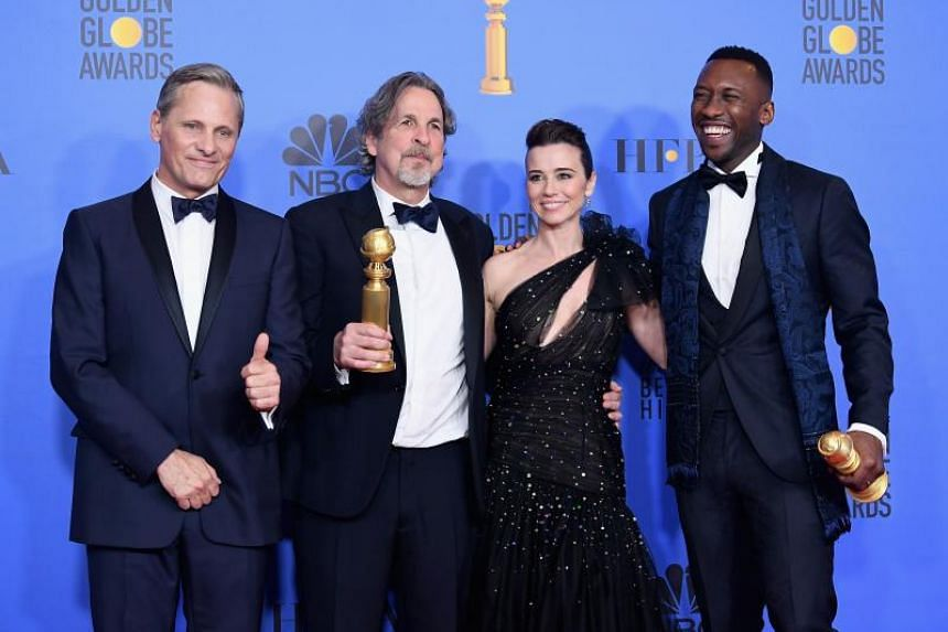 The cast of Green Book pose in the press room with their awards during the 76th Annual Golden Globe Awards at The Beverly Hilton Hotel, in California on Jan 6, 2019.