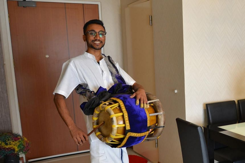 Mr Jathishweran Naidu wearing traditional garments with his thavil strapped across his shoulder. He will be playing the instrument for eight to 10 hours on Thaipusam.