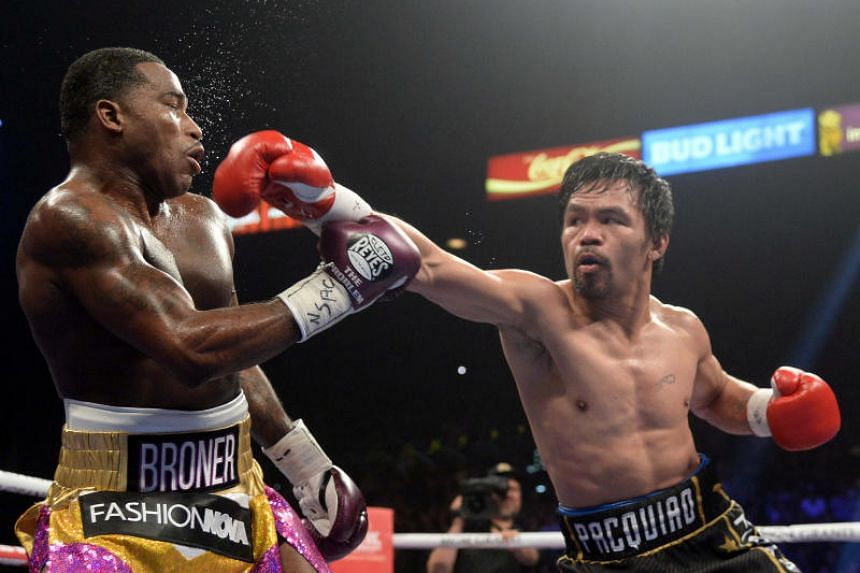 Pacquiao retains welterweight title with win over Broner