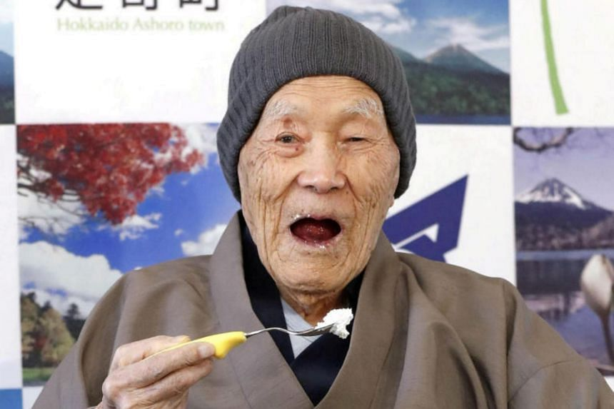 Japanese Masazo Nonaka eats his favorite cake as he receives a Guinness World Records certificate naming him the world's oldest man during a ceremony in Ashoro, Hokkaido, on April 10, 2018.