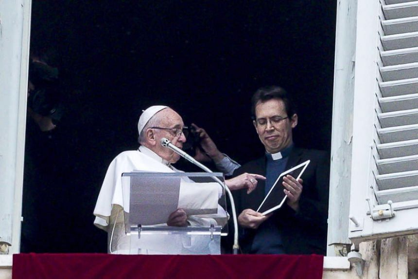 Pope Francis unveiling his own user profile in the Click To Pray app, during the Angelus in St Peter's Square, the Vatican City, on Jan 20, 2019.