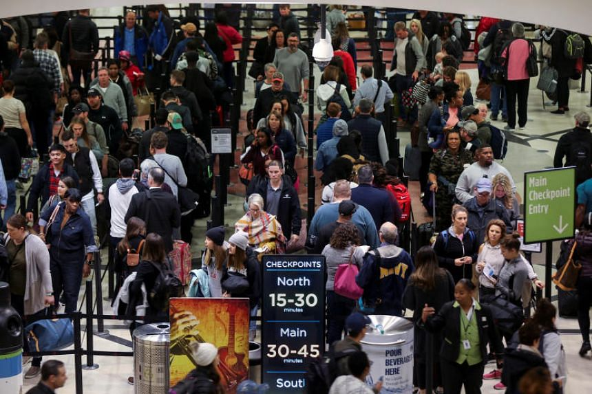 Long lines are seen at a TSA security checkpoint at Hartsfield-Jackson Atlanta International Airport amid the partial federal government shutdown, on Jan 18, 2019.