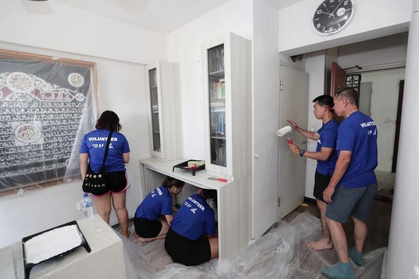 Volunteers helping to refurbish a home in Tampines as part of Project Refresh, on Jan 20, 2019.