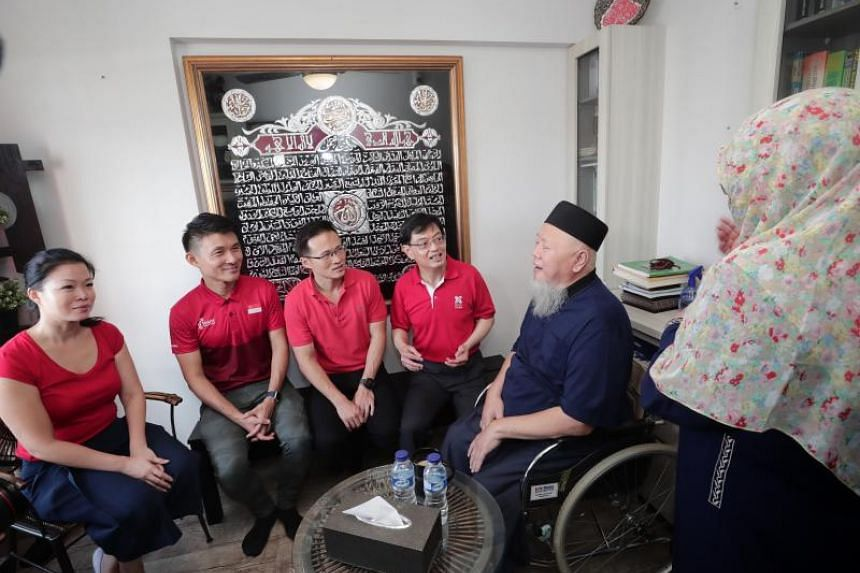 Finance Minister Heng Swee Keat (centre) together with (from left) Tampines GRC MPs Cheng Li Hui, Baey Yam Keng and Desmond Choo, speaking with a resident, on Jan 20, 2019.