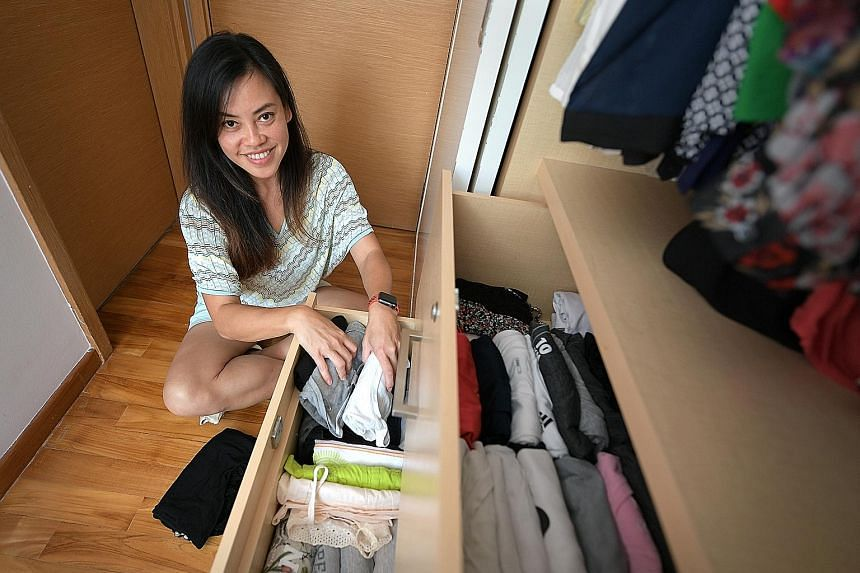 Ms Wang Shijia, owner of local creative studio Ang Ku Kueh Girl and Friends, at her Raffles Place office, which she has organised using Kondo's method. Housewife Casey Lee, who tidied up her wardrobe and drawers using Marie Kondo's method after watch