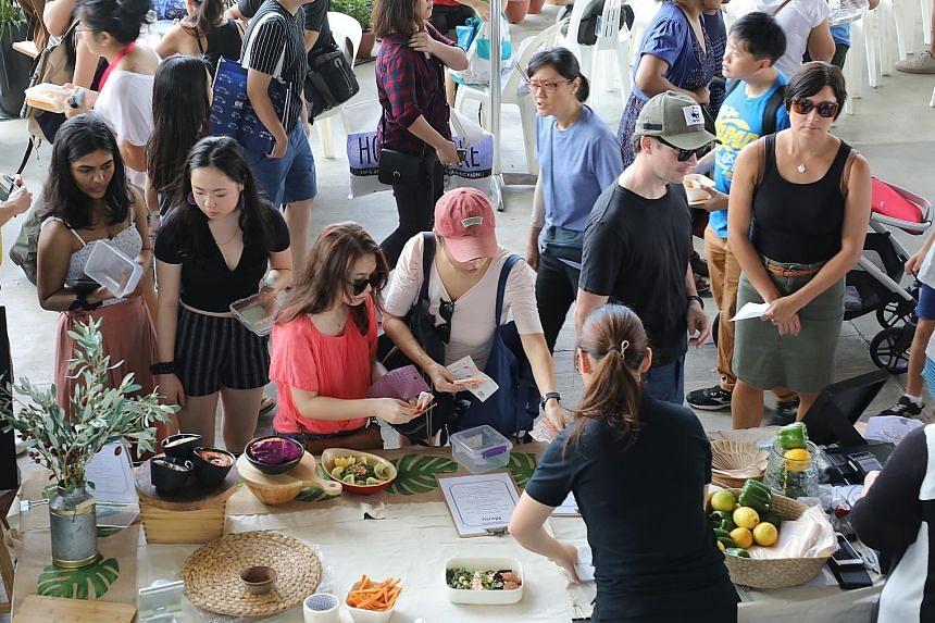 EarthFest Singapore, a sustainability festival to encourage visitors to adopt responsible living habits such as minimalism, plant-based diets and living a zero-waste lifestyle, was held at Marina Barrage yesterday. A book swop and talks were among th