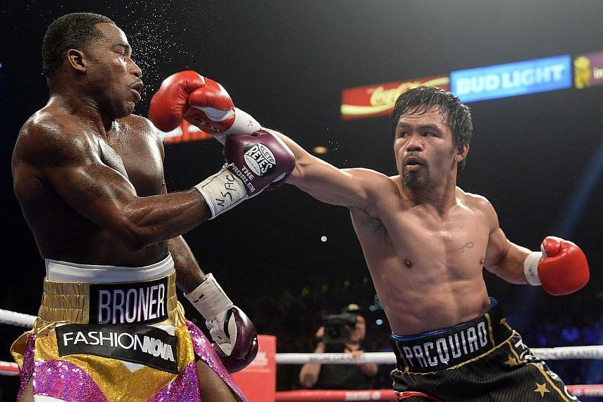 Manny Pacquiao landing a punch on Adrien Broner during their WBA welterweight world title bout at MGM Grand on Saturday. Pacquiao won on all three judges' scorecards, including by one tally of 117-111. The other two judges also had it one-sided at 11