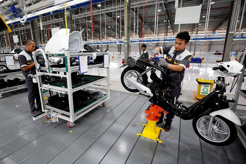 An e-scooter assembly line in a factory in Hai Phong. With Vietnam having a raft of free trade agreements, relatively cheap labour and close proximity to China, Prime Minister Nguyen Xuan Phuc has a good story to tell the global executives he will me