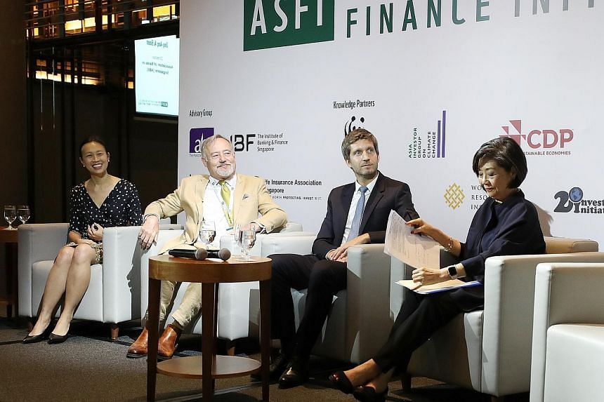 (From left) Deputy chief executive of Institute of Banking and Finance Singapore Lydia Wee, chairman of Investment Management Association of Singapore Nicholas Hadow, chief investment officer of AXA Insurance Singapore and ASFI representative for Lif