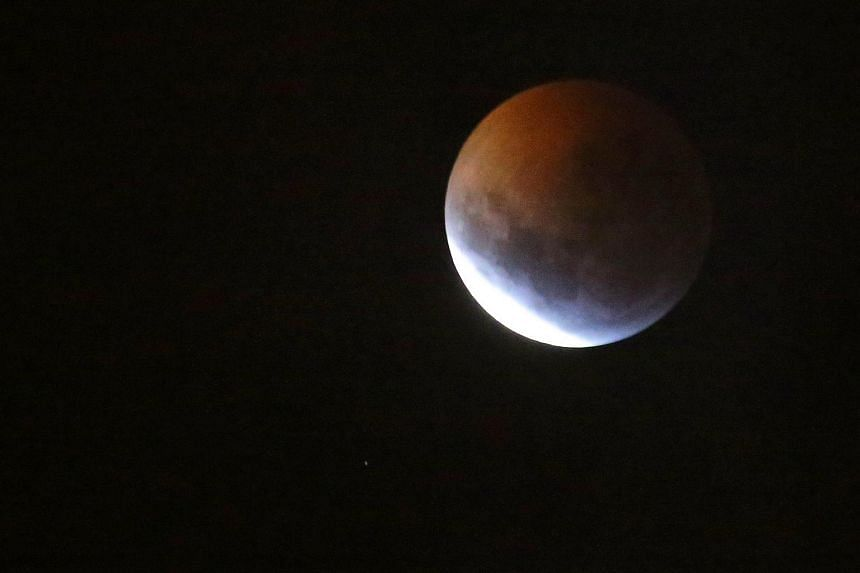 The moon is seen during a lunar eclipse also known as the super blood wolf moon in La Paz Bolivia on Jan 21 2019