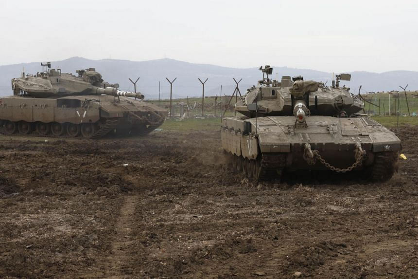 Israel's military said its air defence systems intercepted a rocket fired from Syria, after Damascus accused Israel of carrying out air raids in the country's south.