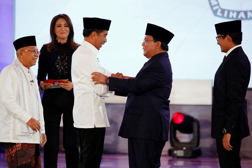 Indonesia's presidential candidate Joko Widodo shakes hands with his opponent Prabowo Subianto after a televised debate in Jakarta, Indonesia, on Jan 17, 2019.