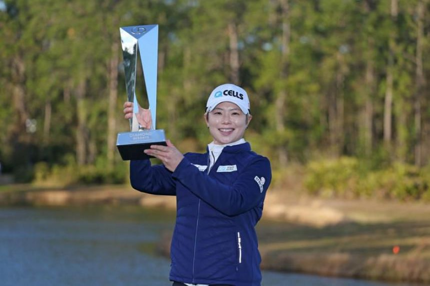 Ji Eun-hee of South Korea poses with the trophy after winning the Diamond Resorts Tournament of Champions at Tranquilo Golf Course at Four Seasons Golf and Sports Club Orlando on Jan 20, 2019.