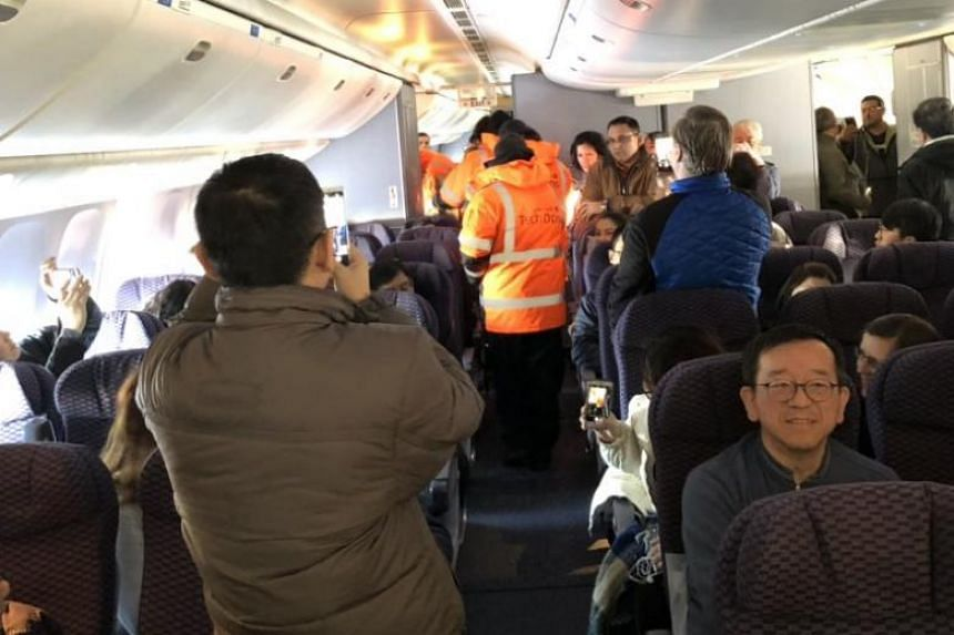 One of the passengers, Sonjay Dutt, reached by phone, said the plane was under-heated and that the arrival of the food and coffee was not enough to appease increasingly angry passengers.