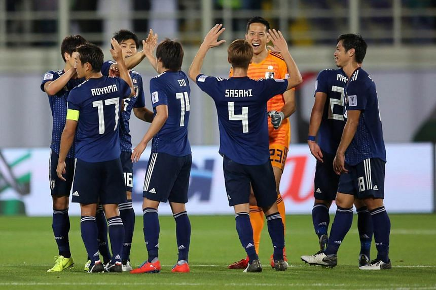 Players of Japan celebrate during the 2019 AFC Asian Cup group F soccer match between Japan and Uzbekistan in Al Ain, United Arab Emirates, on Jan 17, 2019.