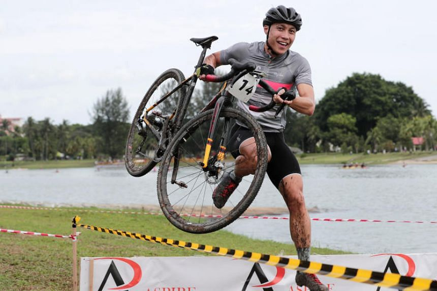 Sebastian Teo leaping across the obstacles at the OCBC Cycle National Cyclocross Championship on Jan 20, 2018.