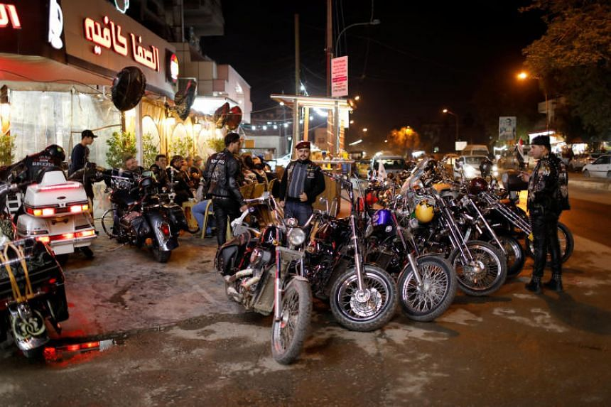 Members of the Iraq Bikers, the first Iraqi biker group, gather outside a cafe in Baghdad, Iraq, on Dec 28, 2018.