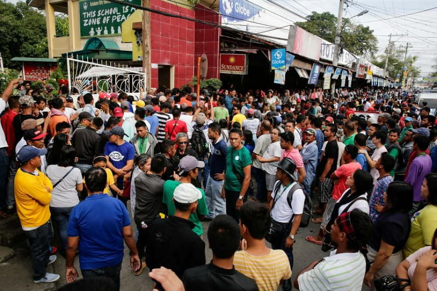 People gather during the plebiscite on the Bangsamoro Organic Law at a polling place in Cotabato, southern Philippines on Jan 21, 2019.