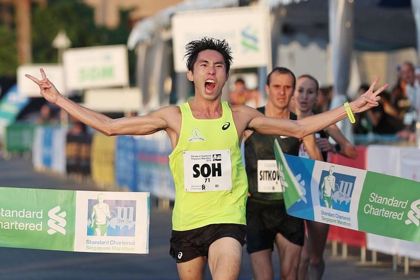 Soh Rui Yong cheers as he runs past the finish line at the Standard Chartered Singapore Marathon 2018 on Dec 9, 2018.