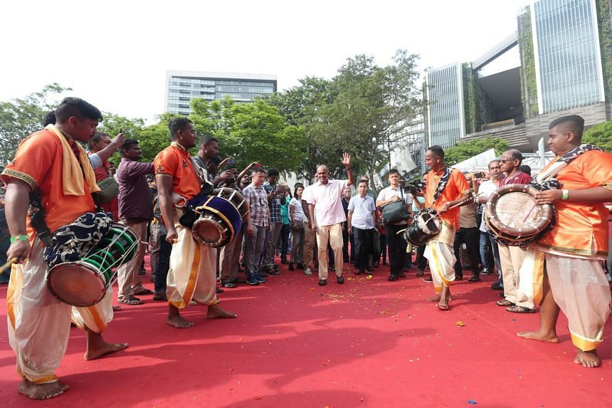 Home Affairs Minister K. Shanmugam meeting urumi musicians from the Siva Mayam Urumi Melam group at a live music station along the procession route on Jan 21, 2019.