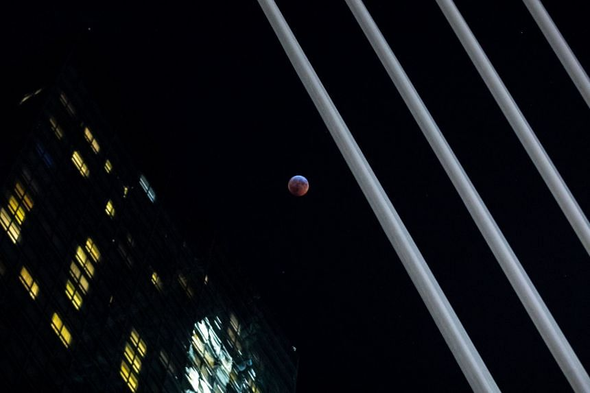 The moon is seen during a total lunar eclipse, known as the super blood wolf moon, in Manhattan, New York, on Jan 20, 2019.