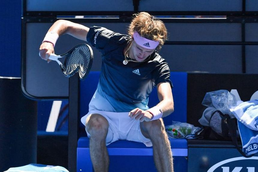 Germany's Alexander Zverev smashes his racquet after a game against Canada's Milos Raonic during their men's singles match at the Australian Open tennis tournament in Melbourne on Jan 21, 2019.