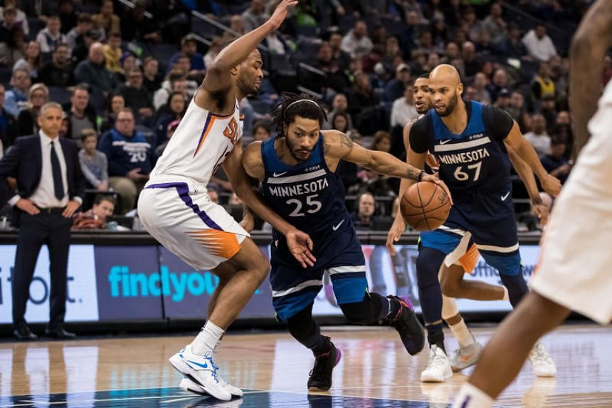 Minnesota Timberwolves guard Derrick Rose (centre) drives in the fourth quarter against Phoenix Suns at Target Center, in Minneapolis, US, on Jan 20, 2019.