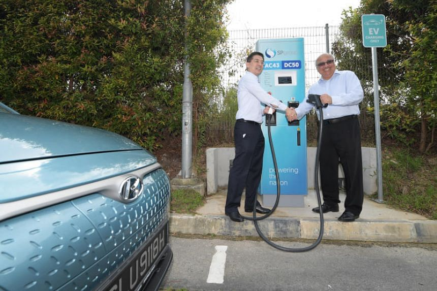 (From left) SP Group CEO Wong Kim Yin and Ascendas-Singbridge deputy group CEO Manohar Khiatani at a high-speed electric vehicle charging station at Hyflux Innovation Centre on Jan 21, 2019.